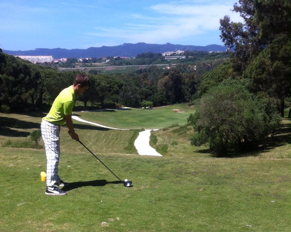 Teeing up on drivable par-4 3rd at Golf do Estoril