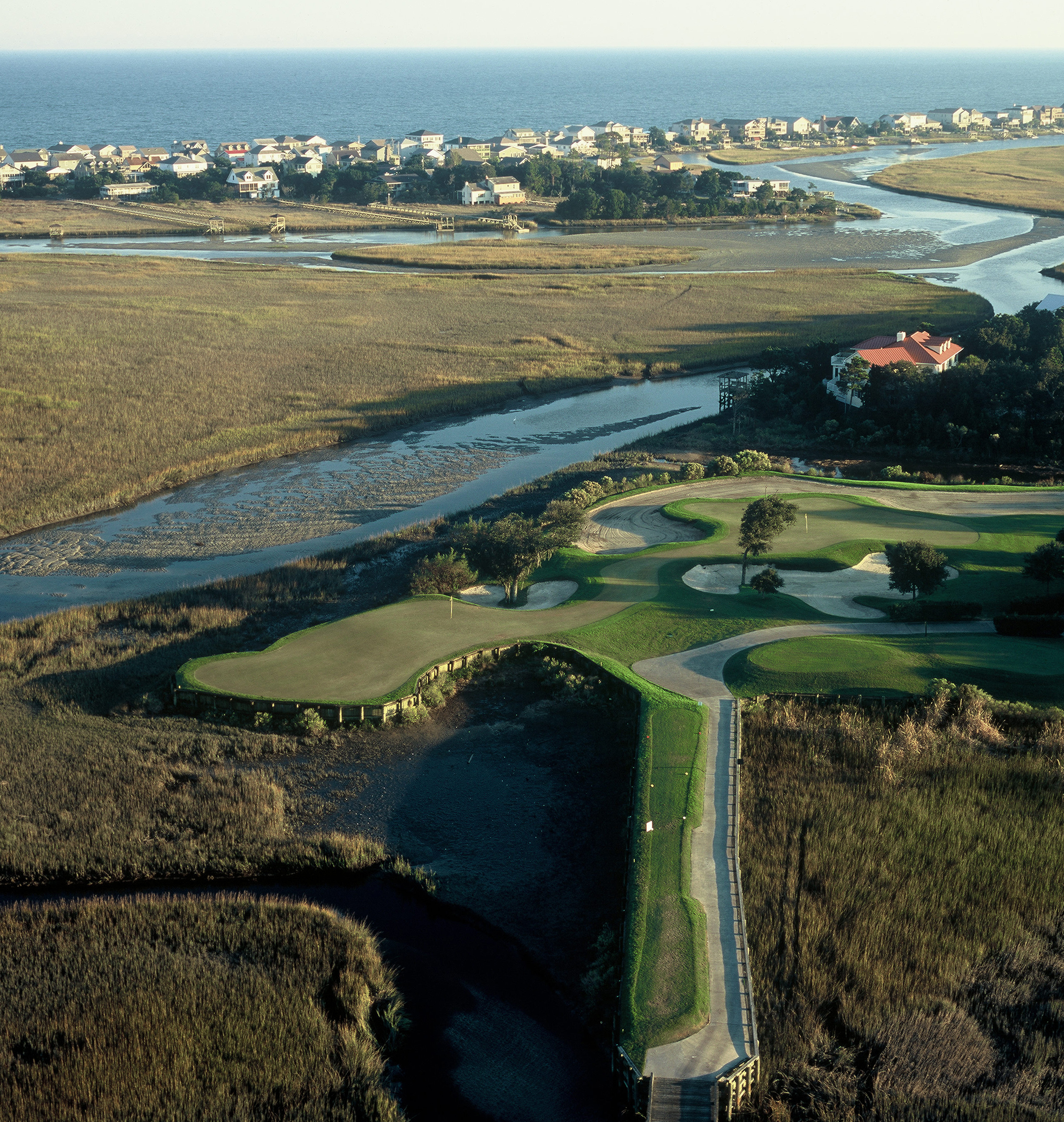 View from the air showing the 13th green and marsh area