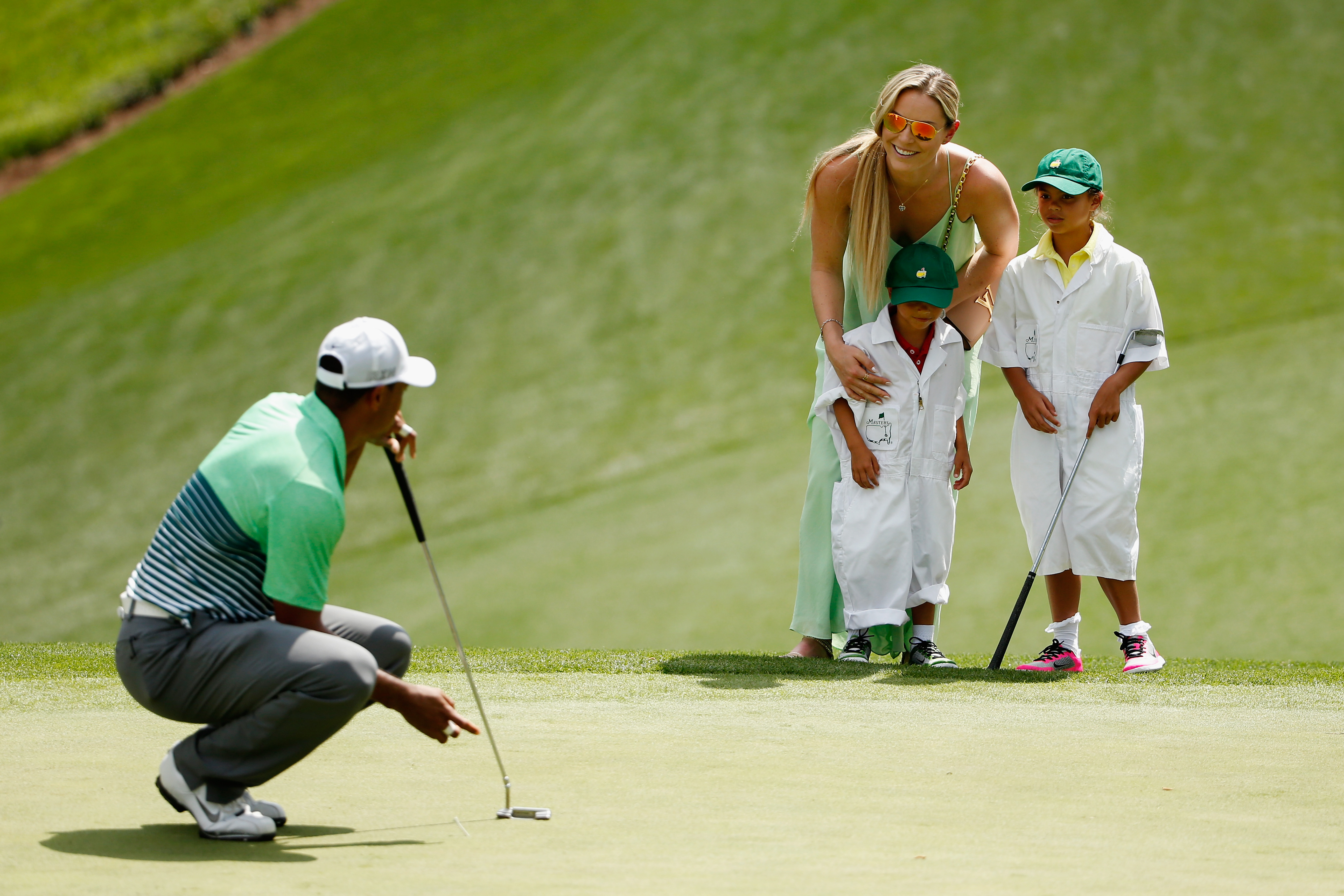 Woods's girlfriend and children joined him for the par- three contest (Photo: Getty Images)