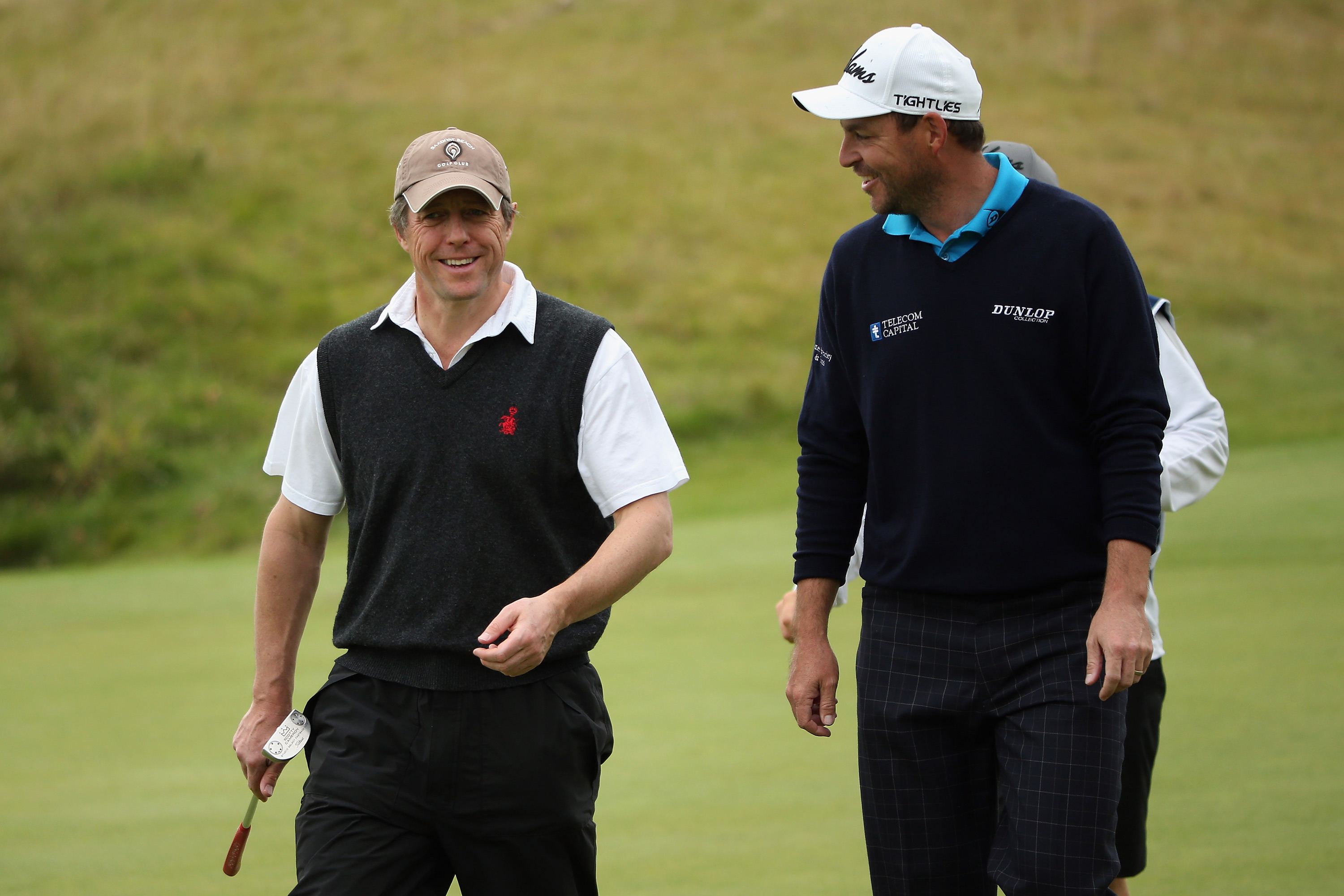 Hollywood actor Hugh Grant shares a joke with Howell at the Dunhill Links (Photo: Getty Images)