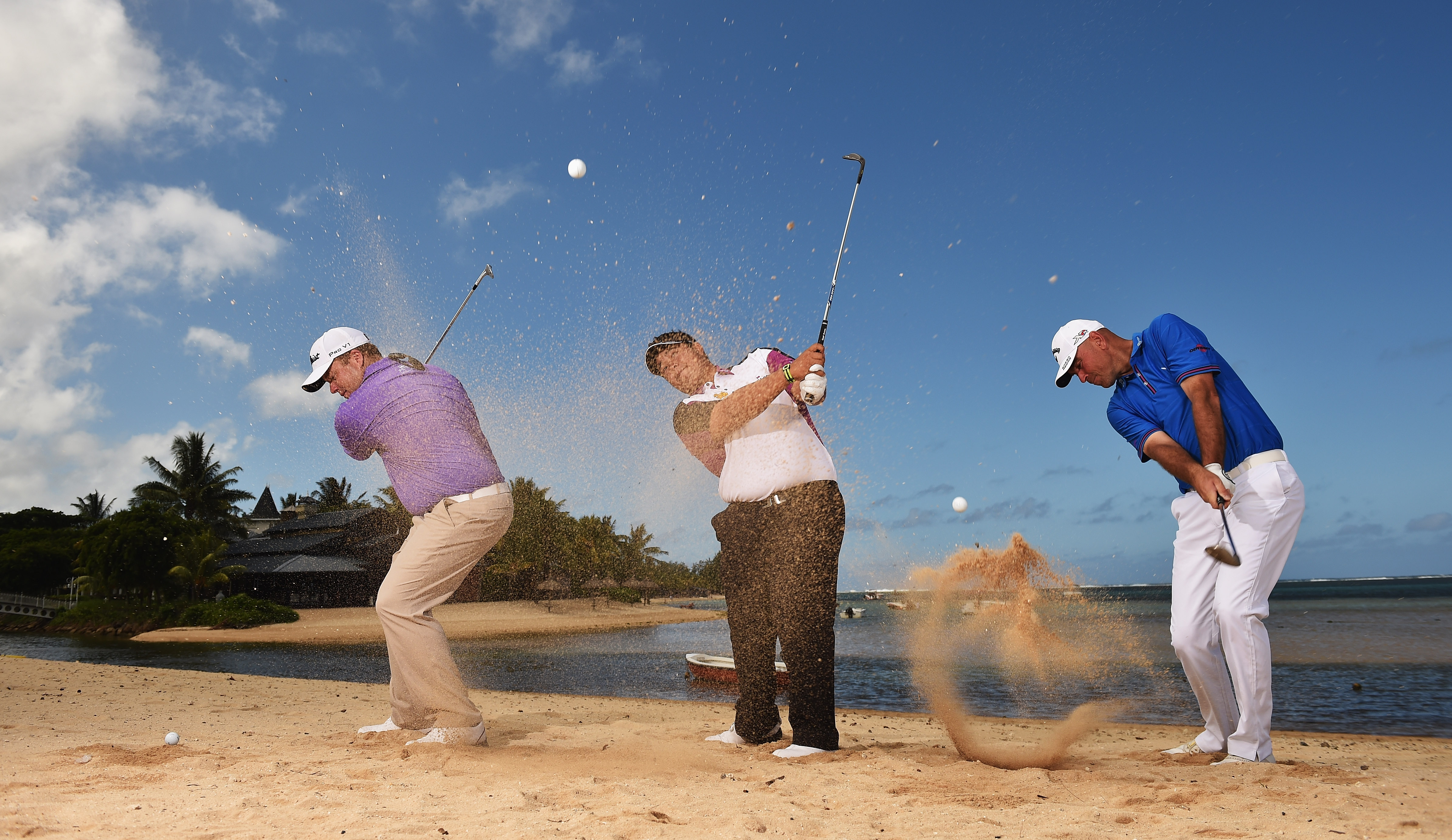 George Coetzee, Kiradech Aphibarnrat and Thomas Bjorn hit shots on the beach ahead of the Mauritius Open (Photo: Stuart Franklin/Getty Images)