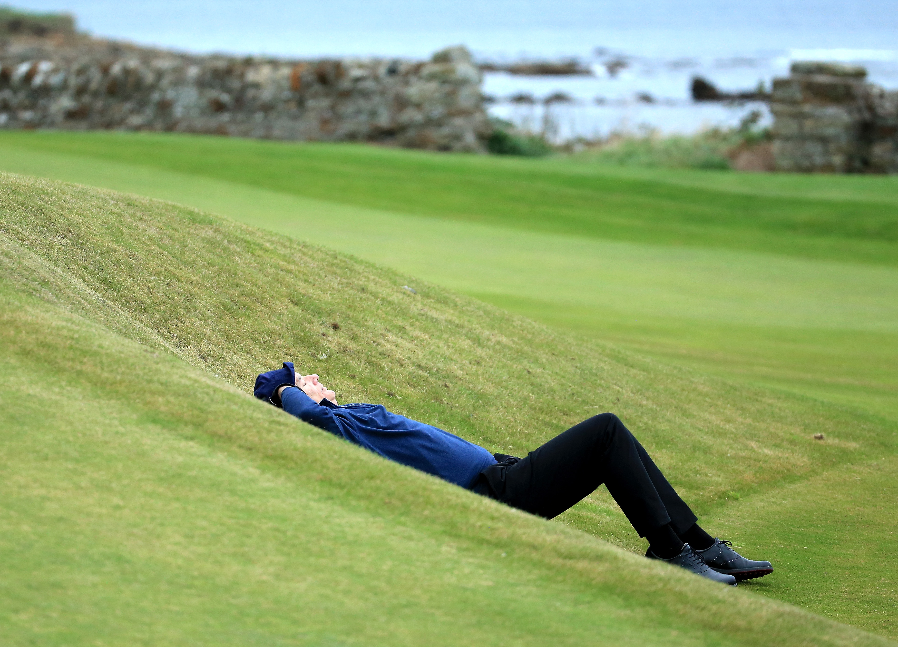 Bill Murray makes the most of an undulating fairway in the Alfred Dunhill Links Championship in 2014 (Photo: David Cannon/Getty Images)