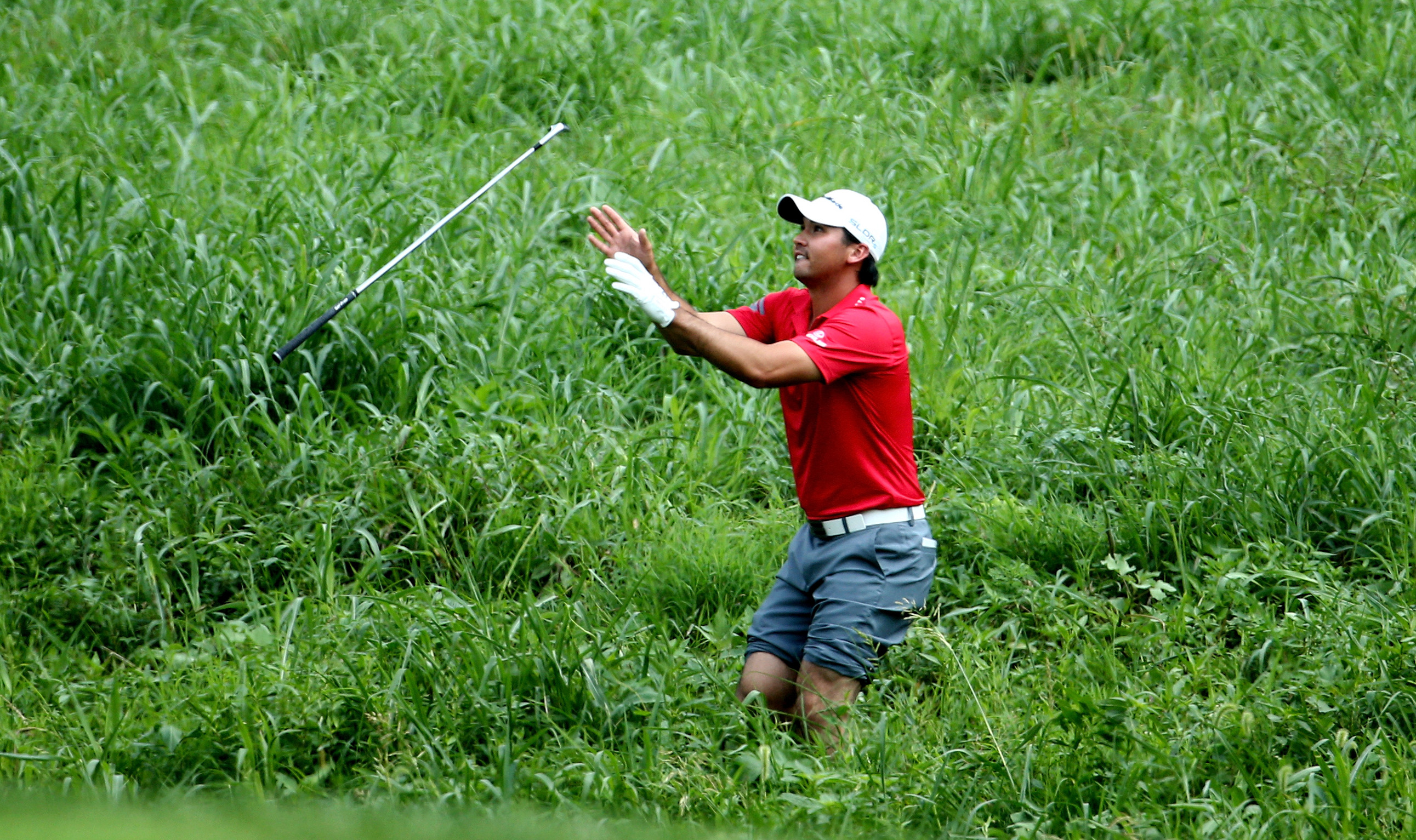 Jason Day prepares to take his shot from the deep grass at Valhalla (Photo: Warren Little/Getty Images)