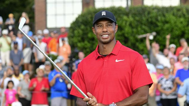 We bet you don't warm up like Tiger Woods