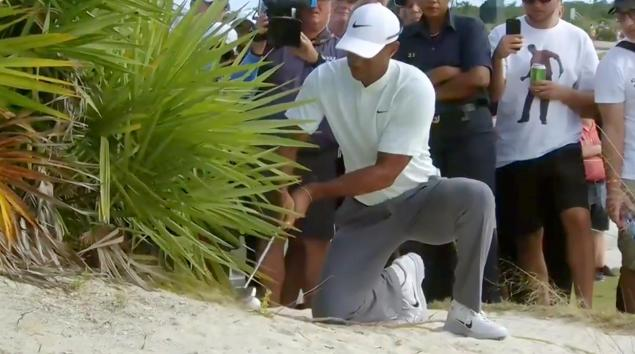Tiger Woods says he double-hit golf shot but officials say no...
