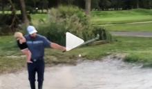 WATCH: Dad shows how to golf and parent at the same time!