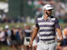 Dustin Johnson shoots 76 on brutal day at US Open, leads by one