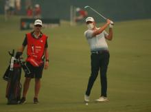Tour pro borrows FACE MASK off golf fan to compete in Australian Open