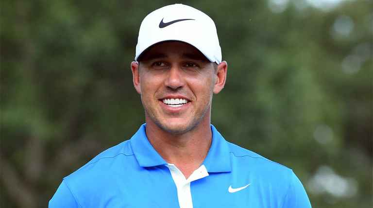 Brooks Koepka moves into share of Tour Championship lead