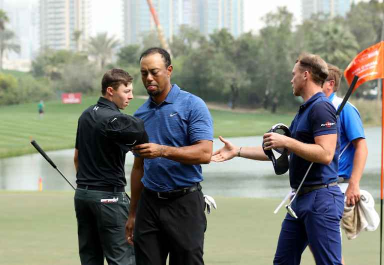 Tiger Woods withdraws with back injury in Dubai