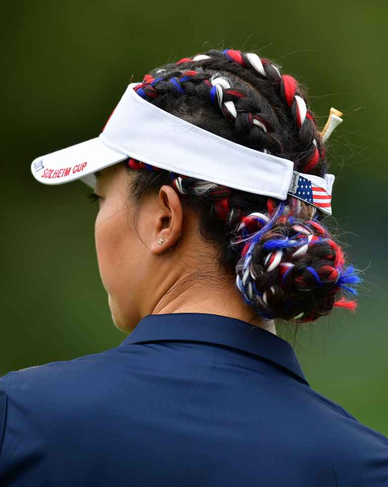 Wie opts for patriotic hair braiding and bling shoes
