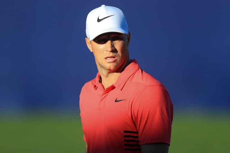Holmes apologises to Noren for taking an age on final hole