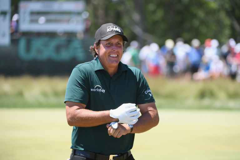 WATCH: Phil Mickelson takes 2-shot penalty for hitting a moving golf ball!