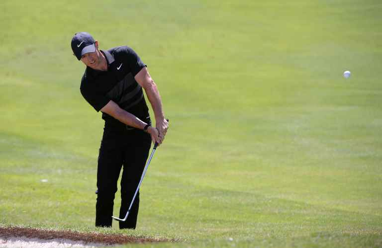 Rory McIlroy fluffs a chip during TaylorMade Driving Relief