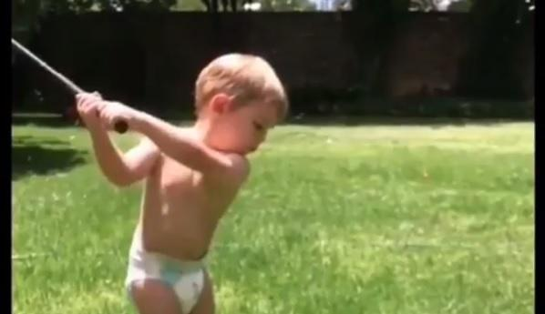 WATCH: This kid in a diaper probably swings it better than you!