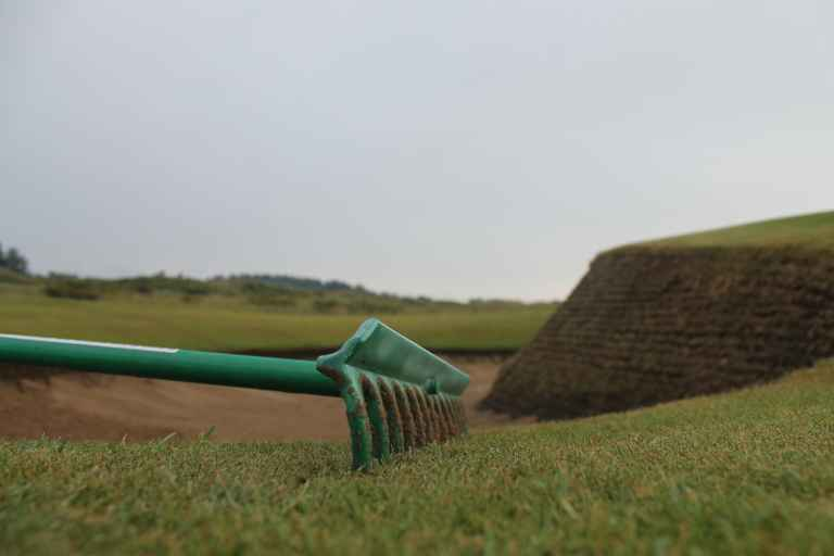 GOLF'S GREAT DEBATE! Do you leave the rake IN or OUT of the bunker?