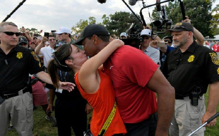 Tiger Woods shares embrace with Erica Herman and fellow Tour pros