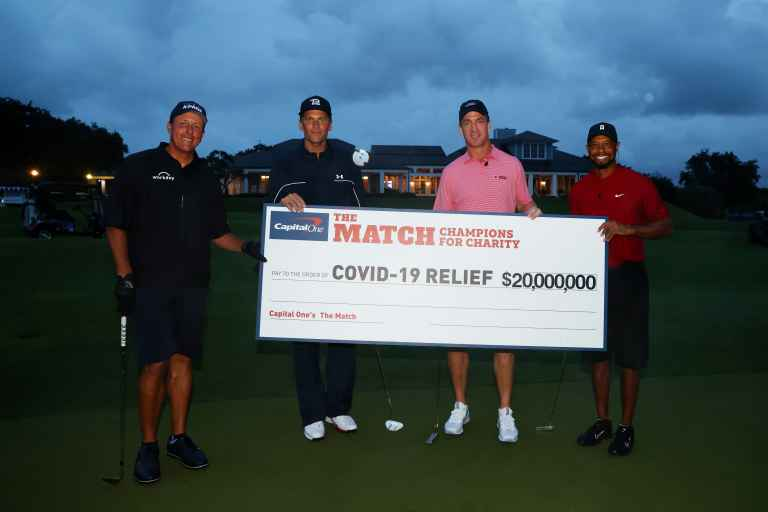 Peyton Manning and Tiger Woods win charity golf event