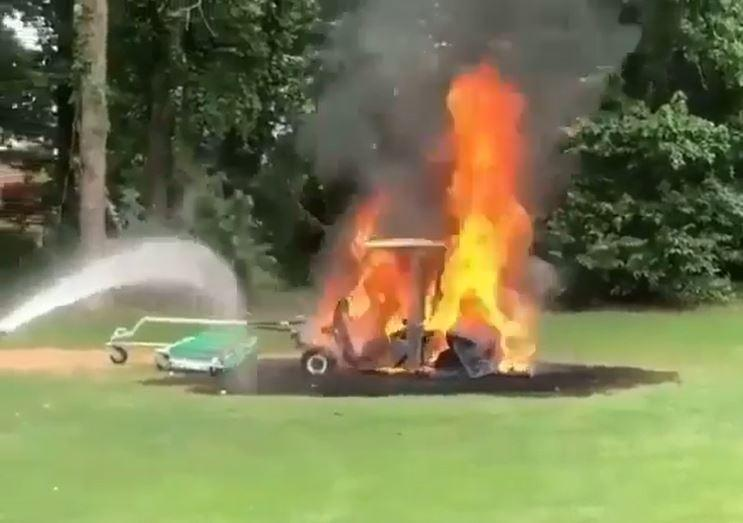 WATCH: Golfers try to put out HUGE golf buggy fire