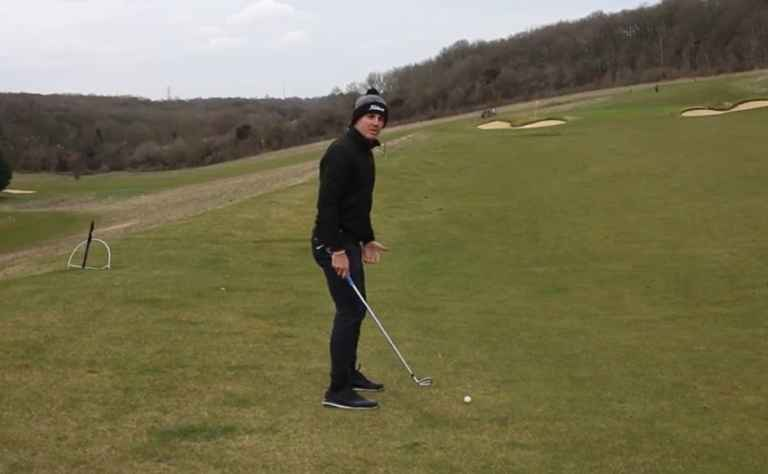 How to PURE your irons from a downhill lie