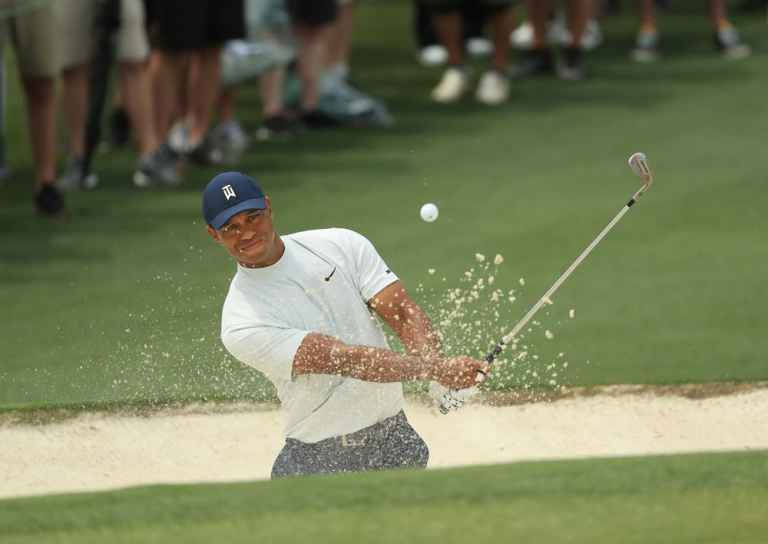 Tiger Woods shows off his strange but very effective bunker drill