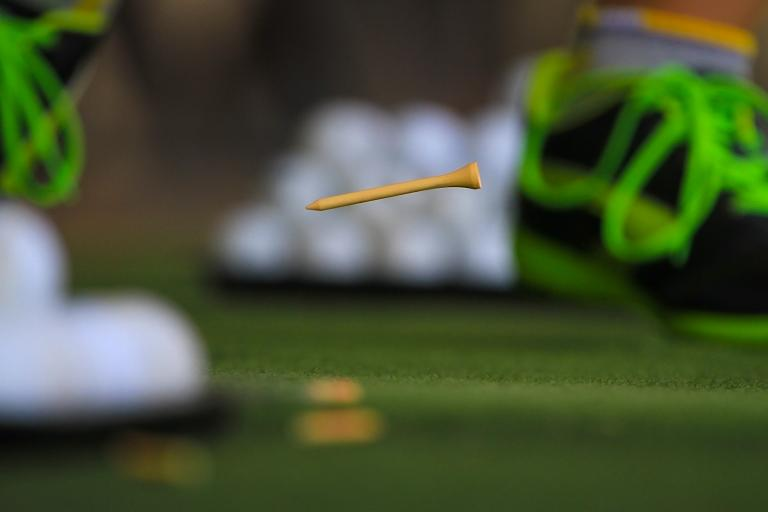 Golfer caught TEEING HIS BALL in the rough during competition