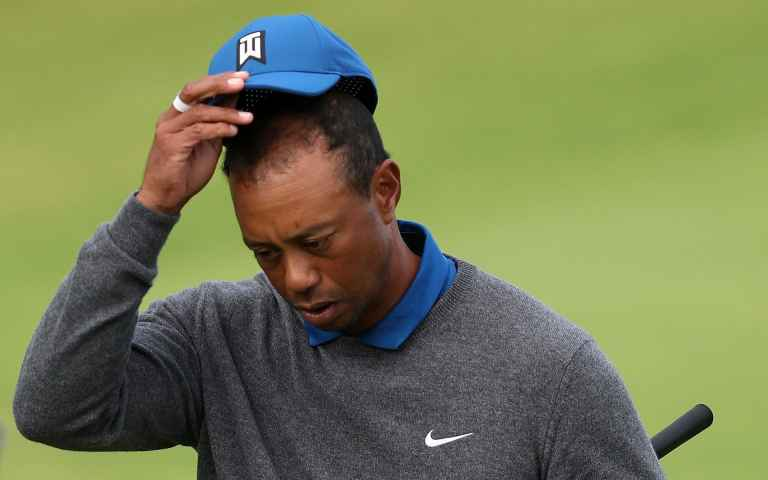 Tiger Woods admits he has injury problems at the Open