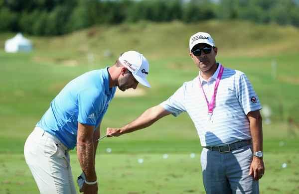 Dustin Johnson SPLITS with golf swing coach Claude Harmon