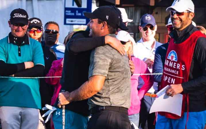 Spieth and Reed hug
