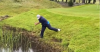 Golf caddie Billy Foster plays INSANE shot from out the water!