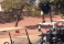 Guy jumps off a golf cart onto another in epic golf fail...