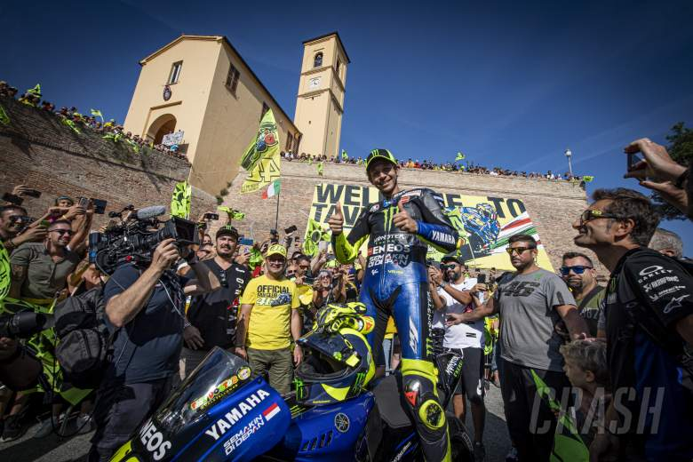 Rossi rides through Tavullia town square on an M1