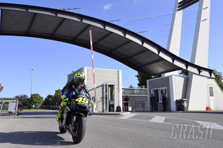 Rossi rides through the entrance to the Misano circuit.