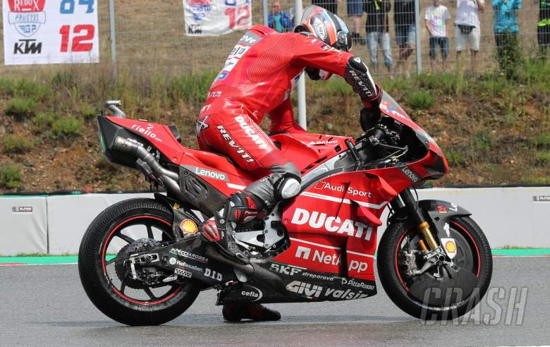 Danilo Petrucci operates his holeshot device