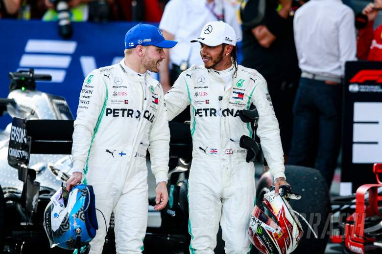 Mercedes F1 drivers race suits to be auctioned for NHS