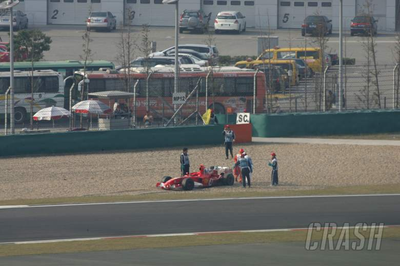 , - Ferrari`s Michael Schumacher spins out of the Chinese Grand Prix