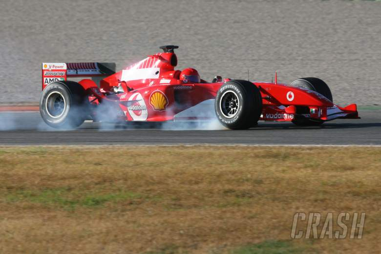 Valentino Rossi locks up the wheels in the Ferrari F2004
