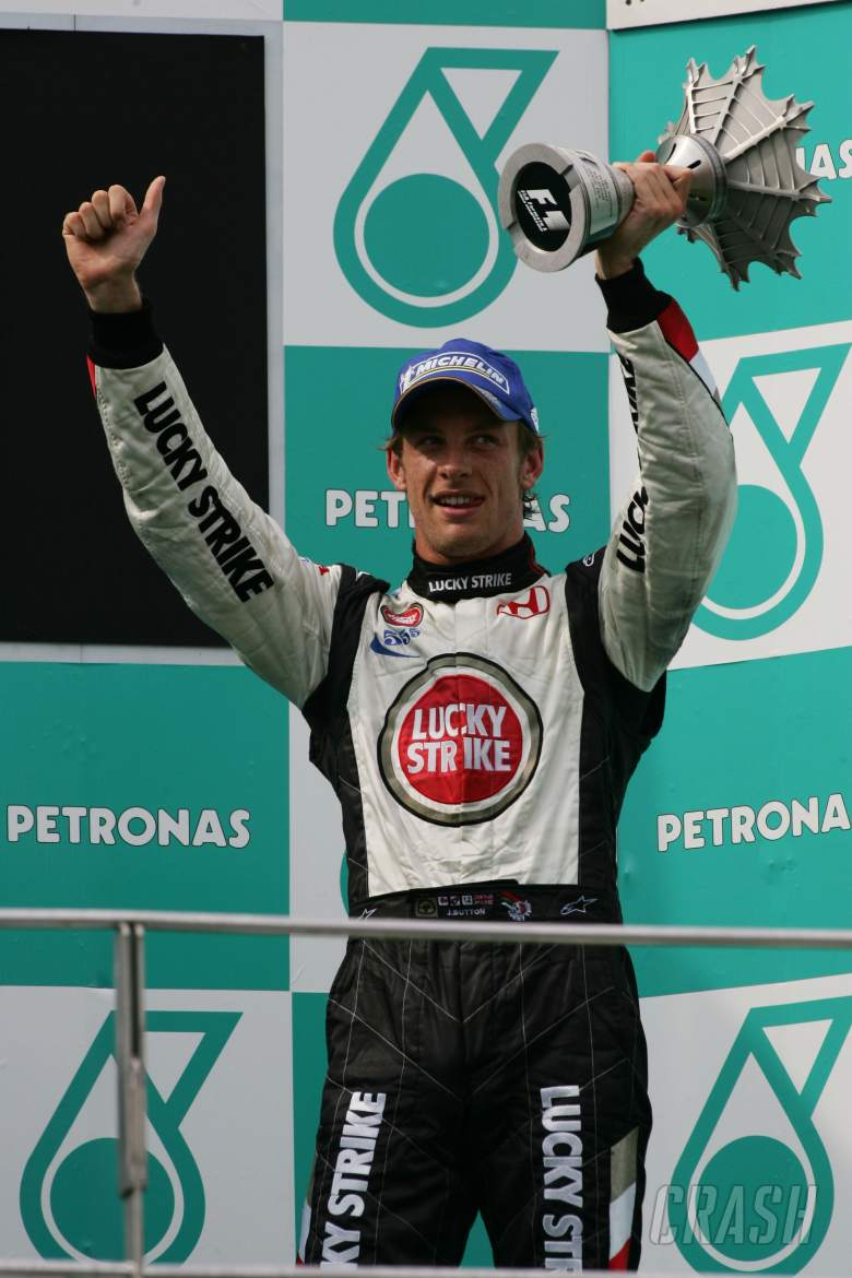 Honda`s Jenson Button celebrates third place in the Malaysian Grand Prix