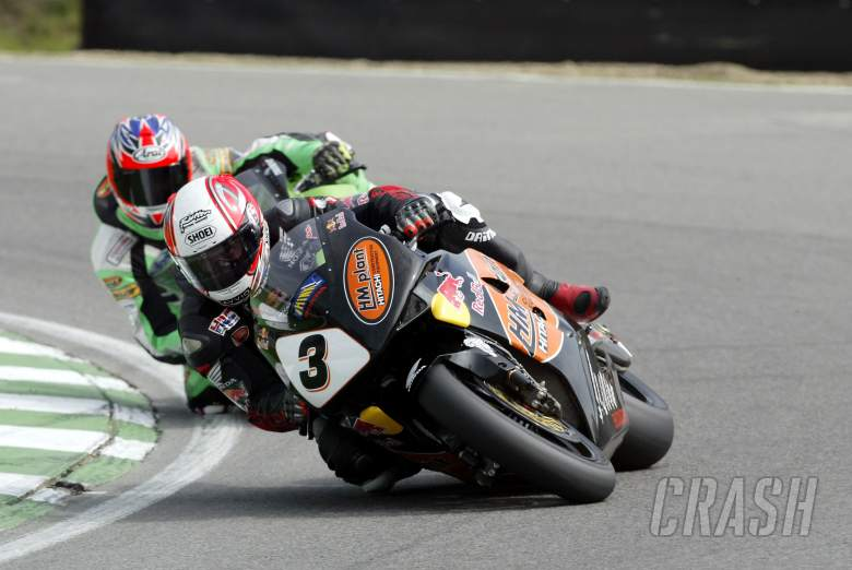, - Michael Rutter HM Plant Honda CBR RR leads Scott Smart on his Hawk Kawasaki