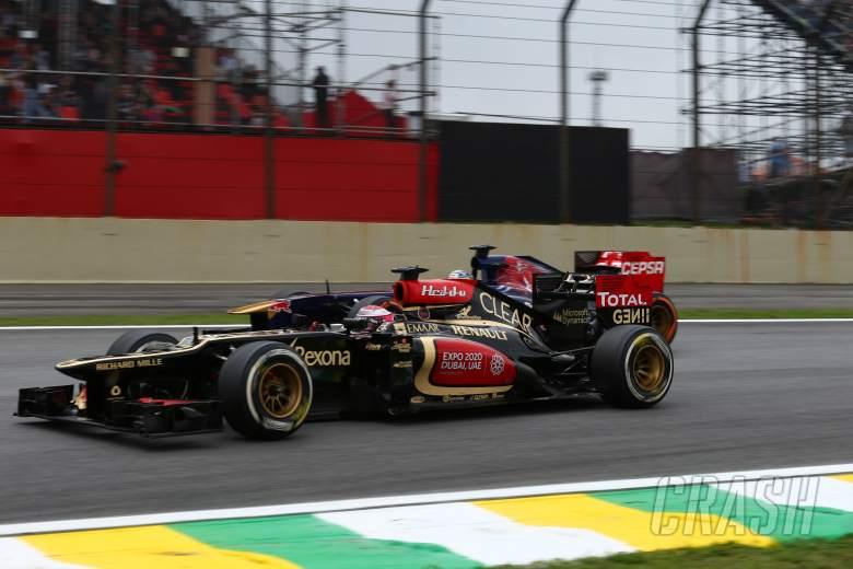 24.11.2013 - Race, Heikki Kovalainen (FIN) Lotus F1 Team E21 and Jean-Eric Vergne (FRA) Scuderia To