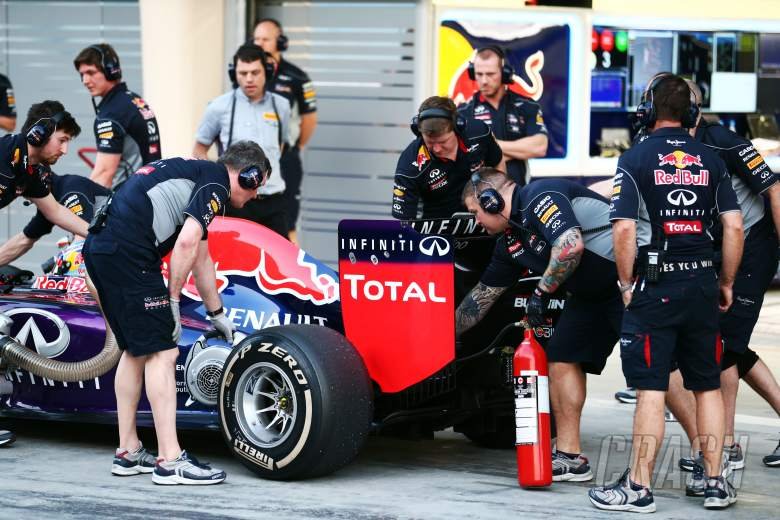 , - Red Bull Racing mechanic with an extinguisher at the rear of the Red Bull Racing RB10 of Daniel Ricc