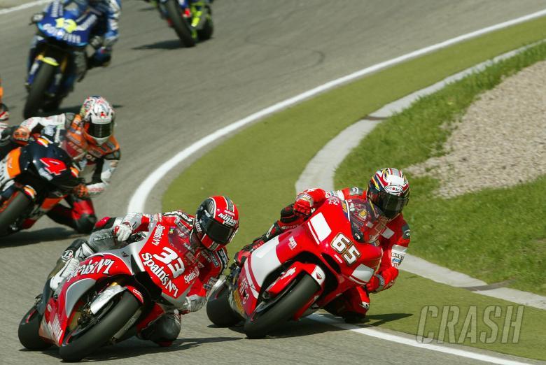 Capirossi Passes Melandri, German MotoGP Race, 2004