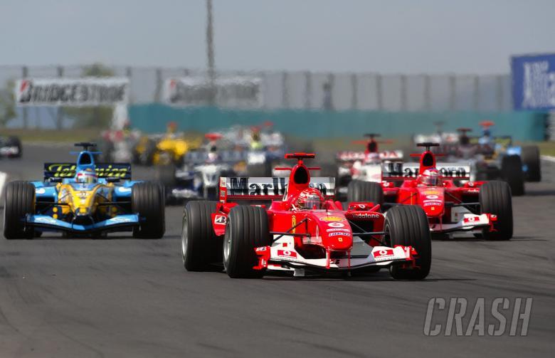 Michael Schumacher leads Ferrari team-mate Rubens Barrichello at the start of the Hungarian GP