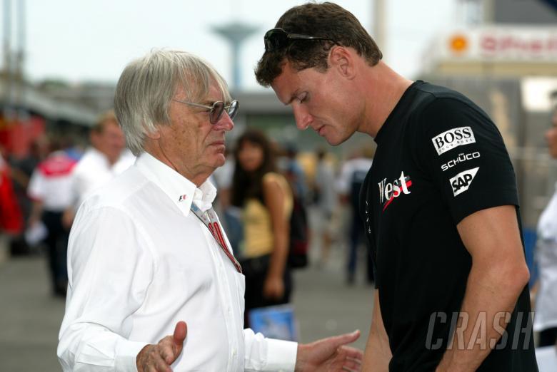 Bernie Ecclestone chats to David Coulthard at the 2004 Brazilian Grand Prix