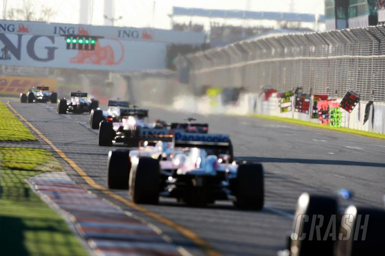 The race restarts after the safety car period led by Jenson button (GBR) Virgin Brawn Mercedes Benz