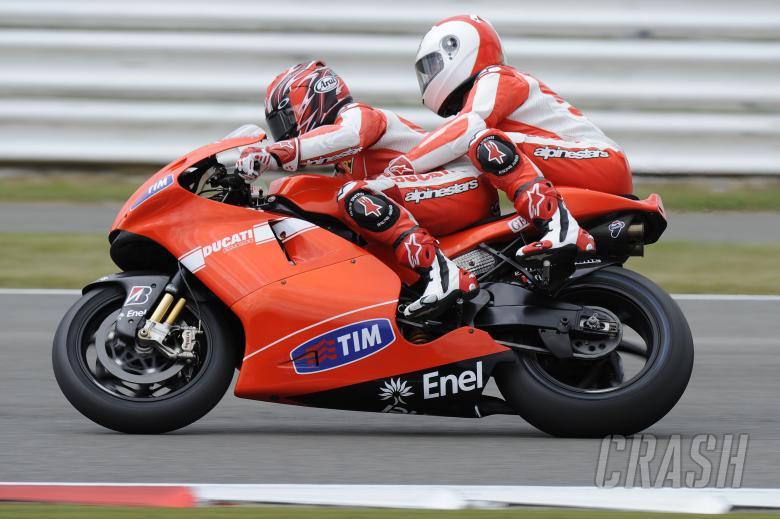 Martin Brundle on the back of Randy Mamola, British MotoGP 2010