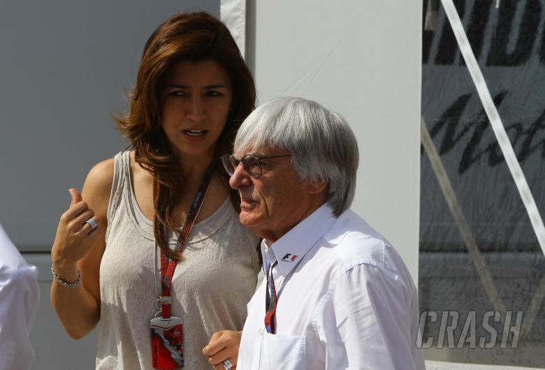 , - Saturday, Bernie Ecclestone (GBR), President and CEO of Formula One Management and his girlfriend F
