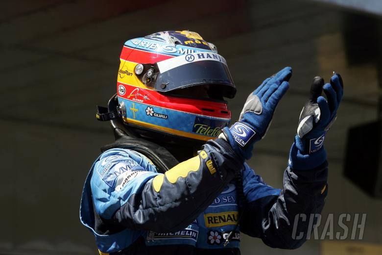 Fernando Alonso acknowledges the Spanish crowd from parc ferme