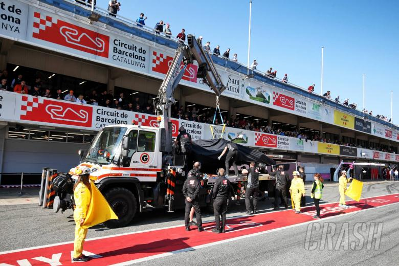 The Haas VF-20 of Kevin Magnussen (DEN) Haas F1 Team is recovered back to the pits on the back of a truck.