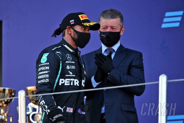 Lewis Hamilton (GBR) Mercedes AMG F1 and Dmitry Kozak (RUS) Former Russian Deputy Prime Minister on the podium.